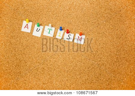 Autism stuck on cork board shot in studio