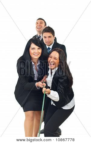 Laughing Businesspeople Playing Tug Of War