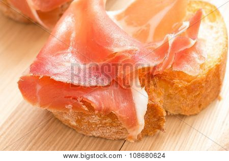 Tapas With Jamon On Grilled Toast Closeup