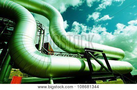 Industrial Zone, Steel Pipelines On Blue Sky