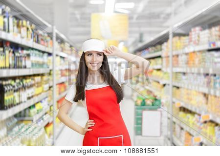 Smiling Supermarket Employee Standing Among Shelves