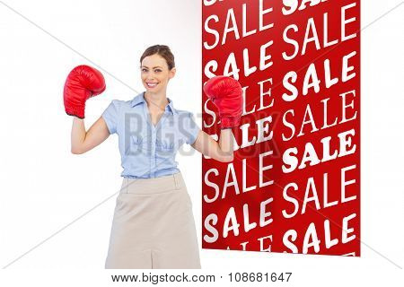 Buisnesswoman posing with boxing gloves against sale advertisement