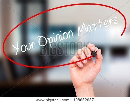 Man Hand writing Your Opinion Matters with black marker on visual screen.