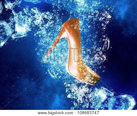 Heeled shoe sinking in clear blue water