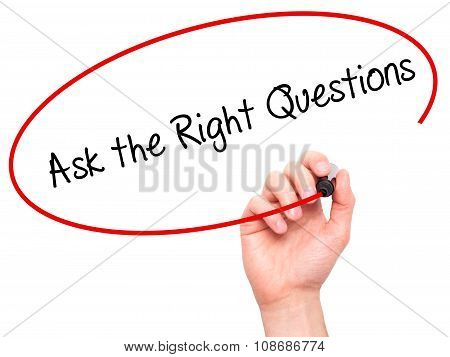 Man Hand writing Ask the Right Questions with black marker on visual screen.