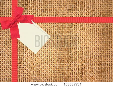 Linen Texture Background With Red Ribbon, Bow And Tag