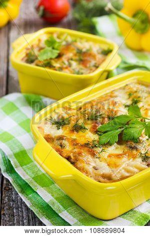 Pasta, Mushrooms And Cheese Gratin In Casserole Dish