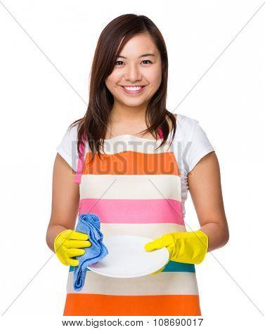 Asian Housewife washing the dish
