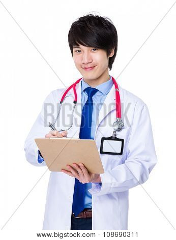 Young doctor write on clipboard