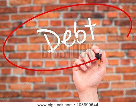 Man Hand writing Debt with black marker on visual screen.