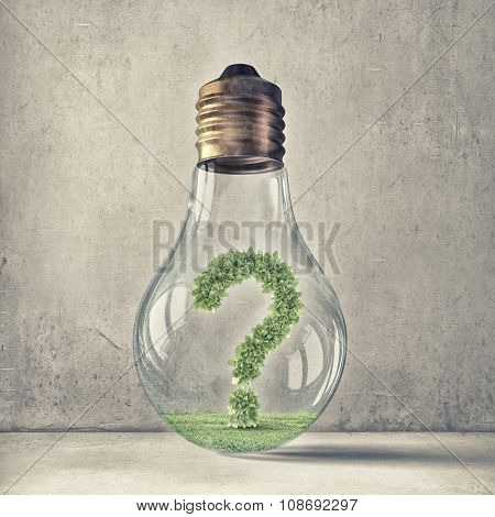Green question mark inside glass light bulb