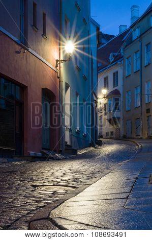 Illuminated Narrow Street At Night In Tallinn Old Town