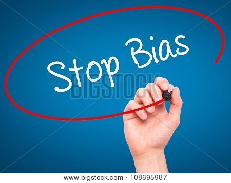 Man Hand writing Stop Bias with black marker on visual screen.