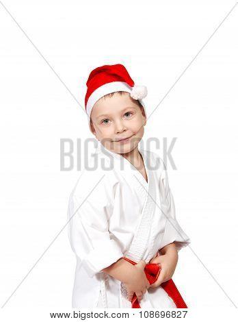 Cute little boy in a kimono and wearing Santa hat