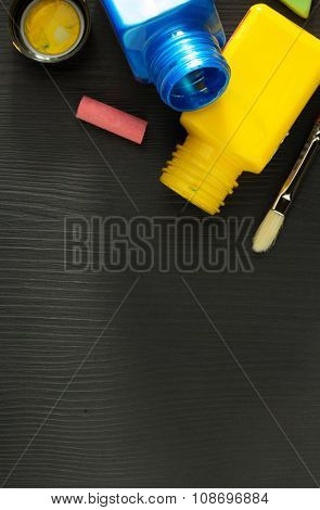 paint and bottle on wooden background