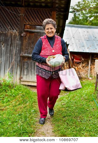 Old Rural Woman With Pumpkin Outdoor