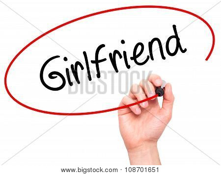Man Hand writing Girlfriend with black marker on visual screen.