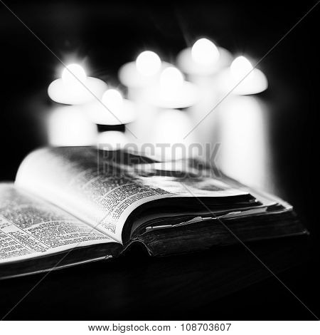 Bible with candles
