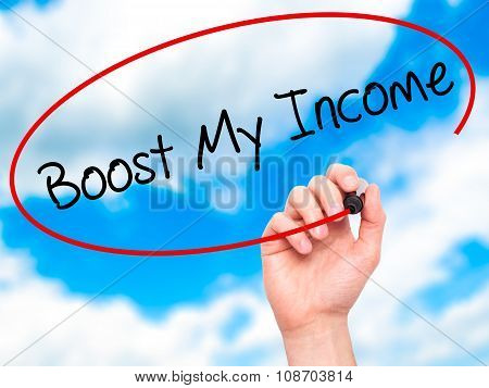 Man Hand writing Boost My Income with black marker on visual screen.