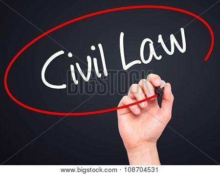 Man Hand writing Civil Law with black marker on visual screen.