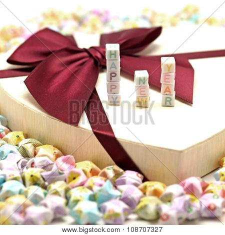 Word Happy New Year On Gift Box With Origami Lucky Stars