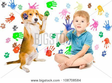 Cute boy with Beagle sitting  on the background of handprints