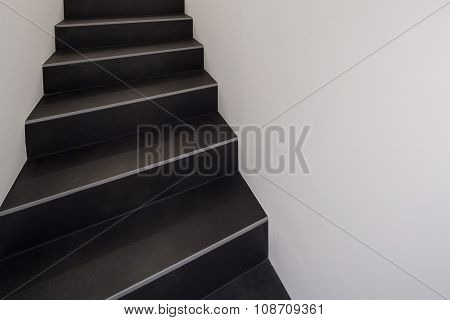 Interior of a modern apartment, black staircase
