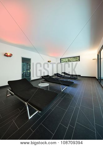 interior of a modern spa, room with sunbeds