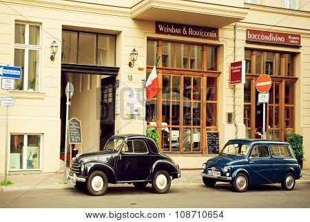 Vintage Rare Automobiles Parked Past Historical Buildings Street Of Berlin