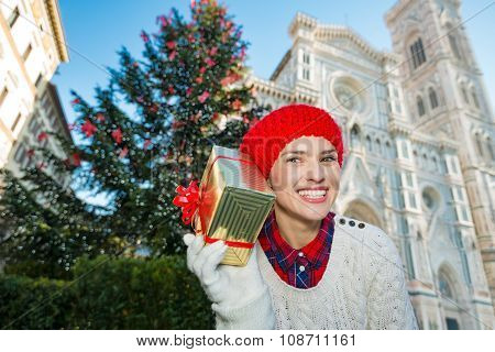 Happy Woman Holding Gift Box Near Christmas Tree In Florence