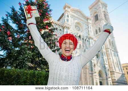 Woman Tourist Holding Gift Box Near Christmas Tree In Florence