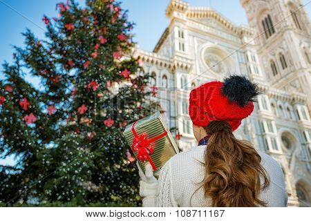 Seen From Behind, Woman Holding Christmas Gift Box In Florence