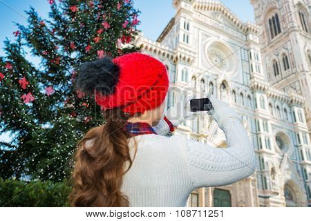 Woman Taking Photo Of Duomo Of Christmas Decorated Florence
