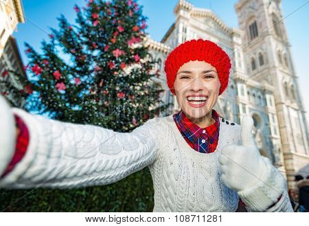 Woman Tourist Taking Selfie In Christmas Decorated Florence