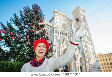 Woman Pointing On Something Near Christmas Tree In Florence