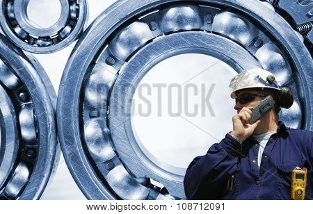 industry worker and giant ball-earings in the background