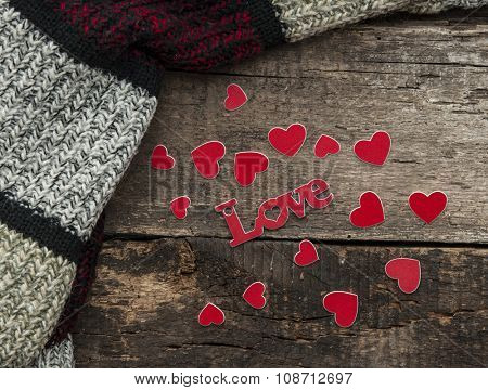 Small red hearts on old wooden background. I love you.