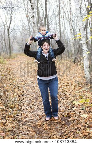 mother with his boy in the forest