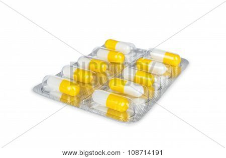 Bright Yellow Capsule In A Package Isolated On White Background