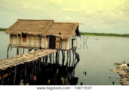 House on stilts in lake
