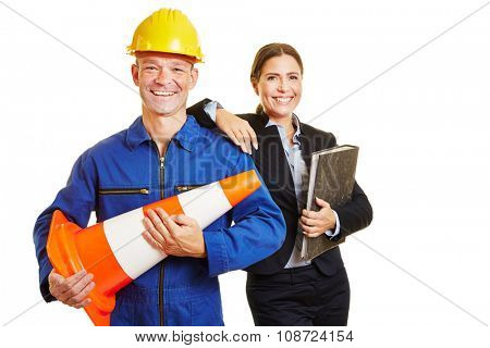Construction worker and business woman smiling together as a dynamic team