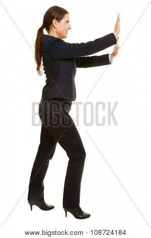 Isolated full body business woman pushing imaginary wall