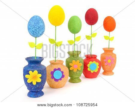 Colourful Easter eggs in a vase