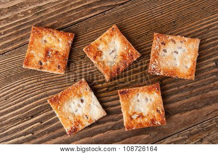 Crackers On A Wooden Background