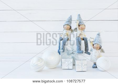 Christmas Background. Christmas Composition With White Gift Box And Gnomes. Copy Space
