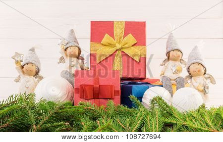 Christmas Composition With Red Gift Boxes, Angels And Fir Tree