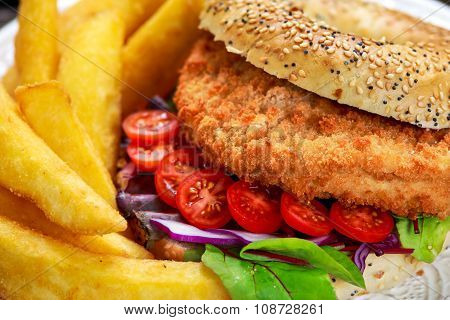 Home Made Close Up Chicken Burger With Fried Potatoes