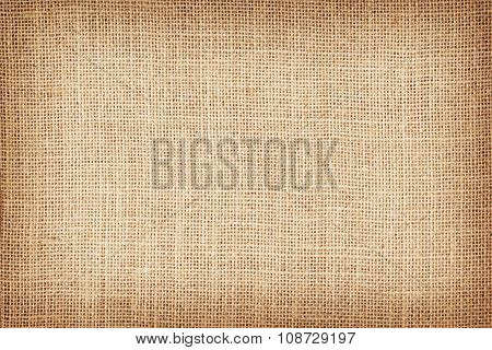 Natural brown sackcloth fabric texture or background.