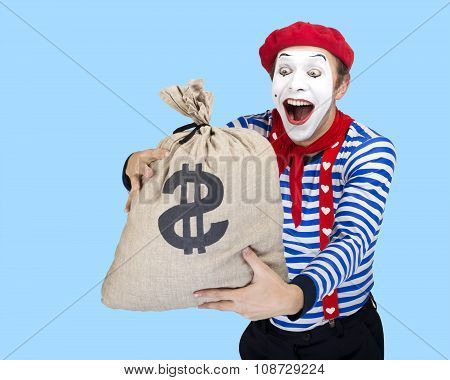 Mime with money bag.Emotional funny actor wearing sailor suit, red beret posing on blue background.