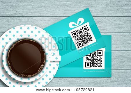 Discount Coupons Lying On Wooden Desk With Coffee